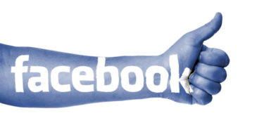 image of arm with facebook written on it